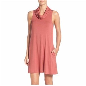 Socialite blush colored cowl necked dress.